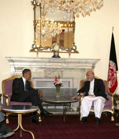 U.S Democratic presidential candidate Sen. Barack Obama (L) meets with the Afghan President Hamid Karzai at the presidential palace in Kabul July 20, 2008. REUTERS/Afghanistan Presidential Palace handout (AFGHANISTAN)